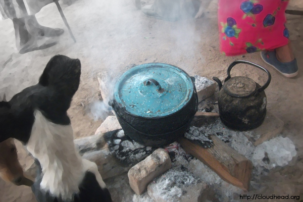 Around the fire, waiting for food in a Wichi village in Hickmann, Argentina