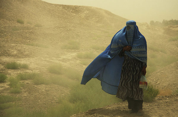 Women in burqa in sandstorm